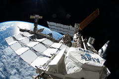 space station experiment is close to proving the existence of dark matter, the cosmic glue that binds the universe